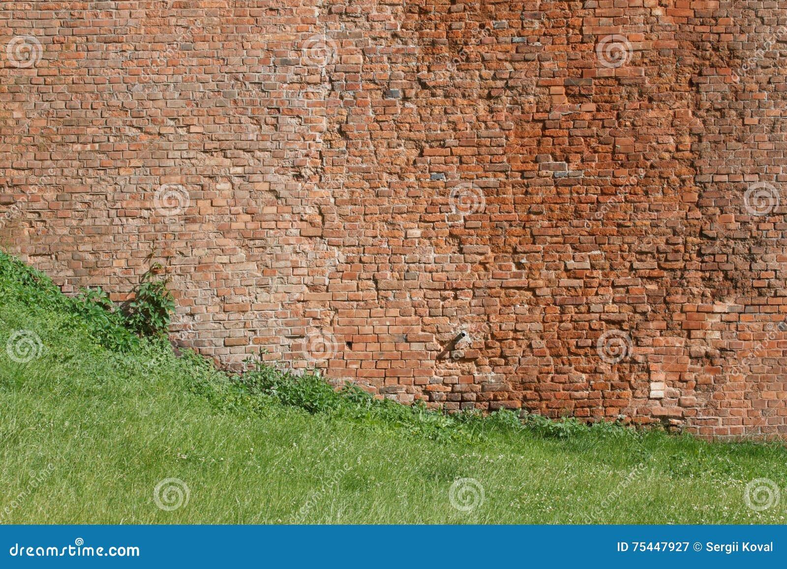 De textuur van de bakstenen muur van een oud kasteel, close-up Ho
