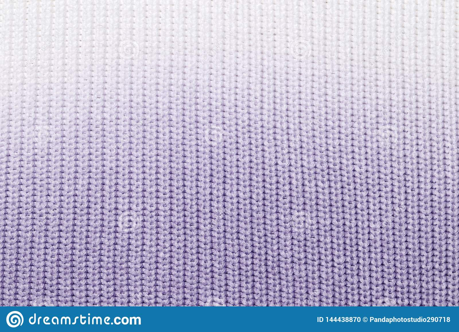 De textuur van een gebreid wollen stoffenblauw
