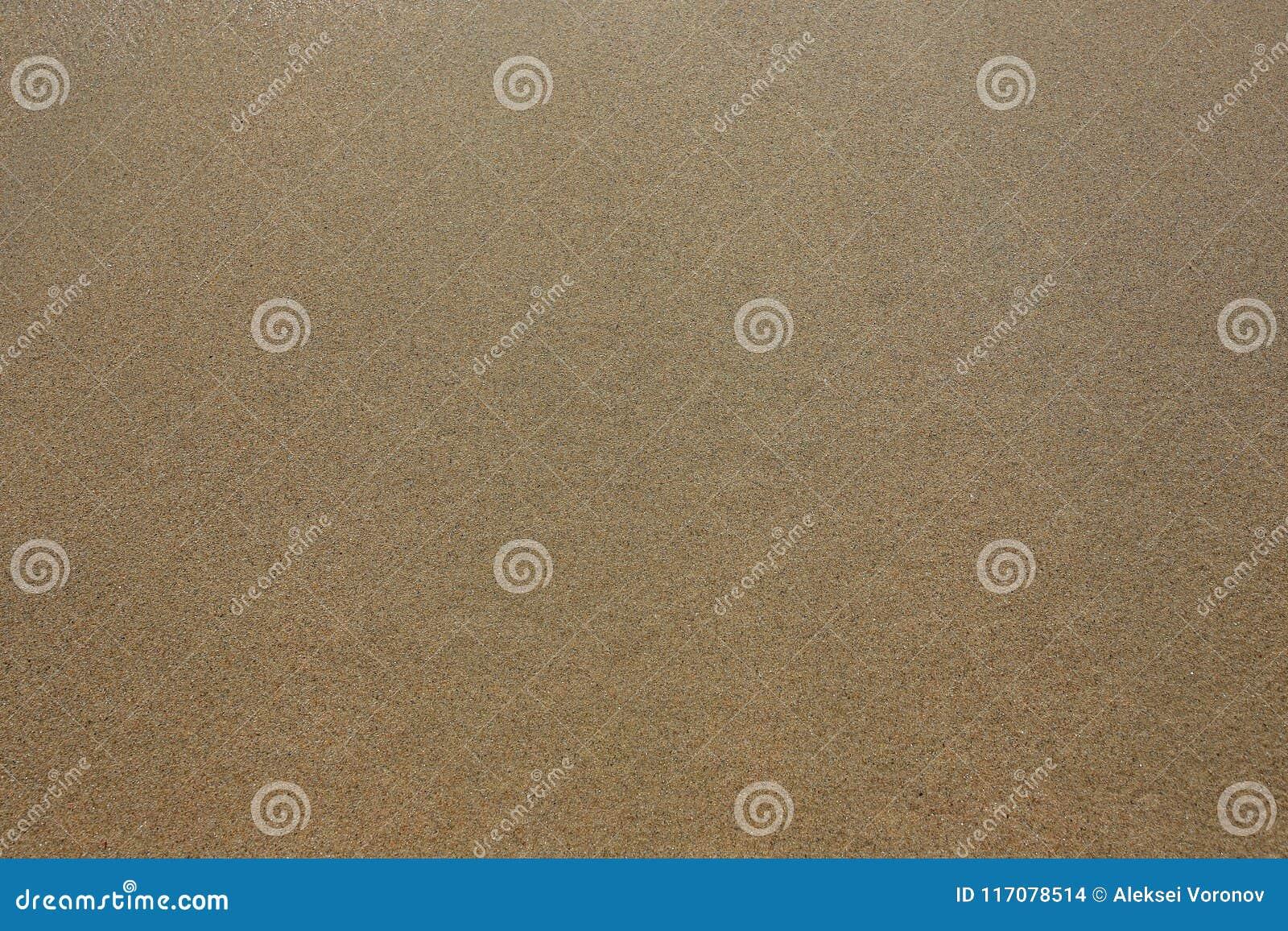 De textuurachtergrond van het zand