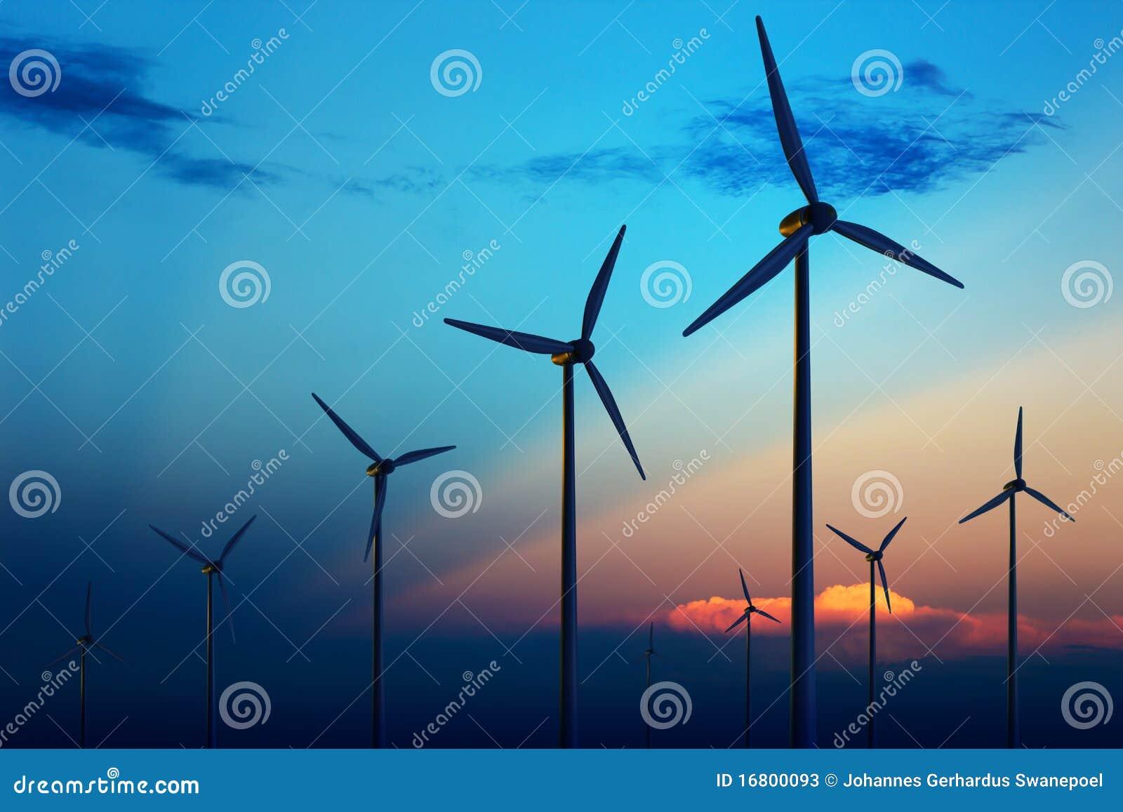 De turbinelandbouwbedrijf van de wind bij zonsondergang