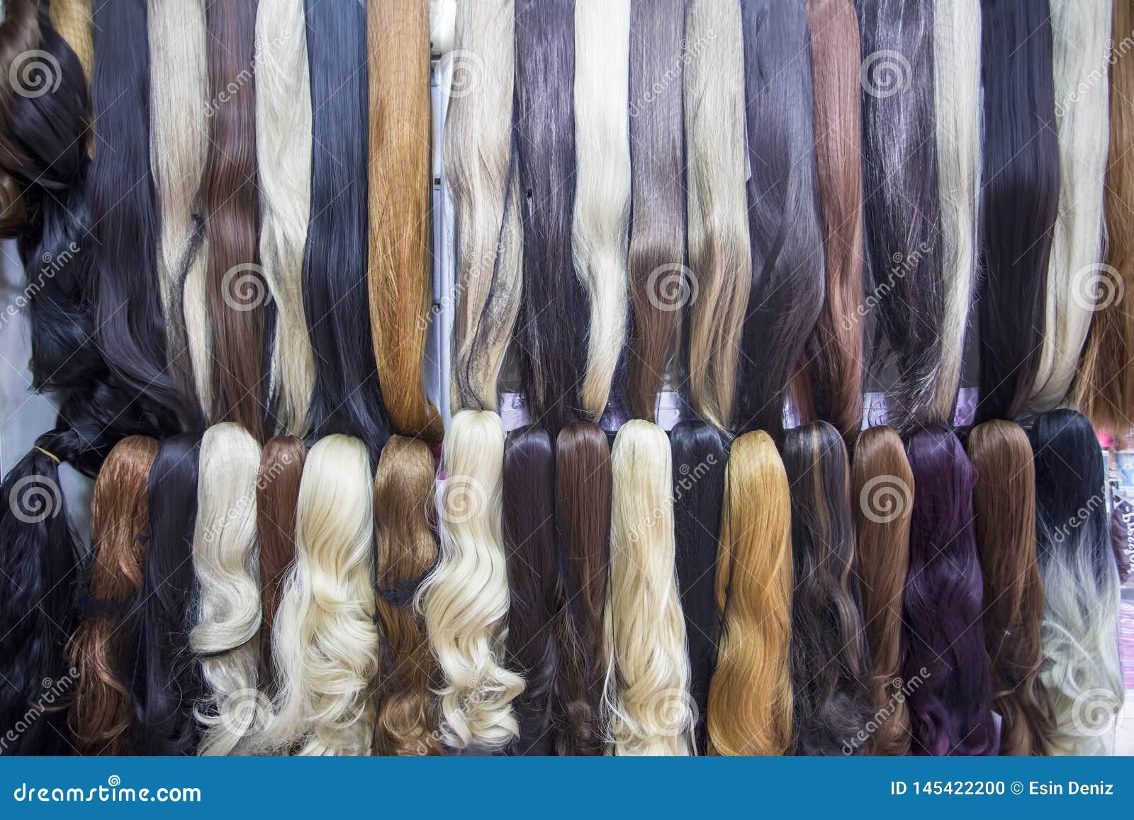 De verschillende uitbreidingen van het kleuren menselijke haar in pruikenwinkel