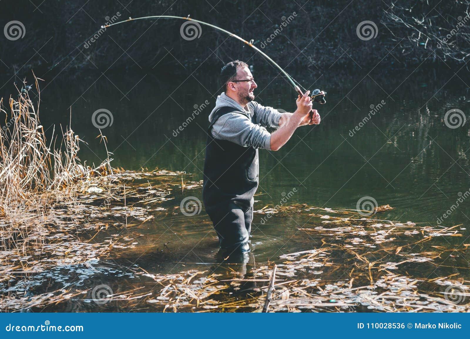 De visser werpt een haak