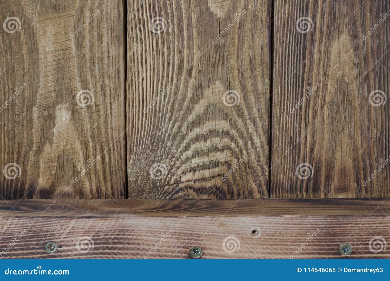 De weefselachtergrond van houten raad schikte verticaal en één horizontale raad