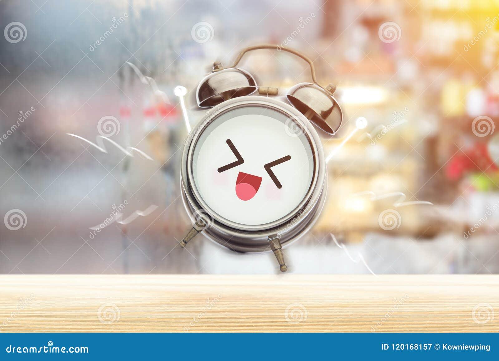 De wekker is gelukkig in de ochtend bij de slaapkamer