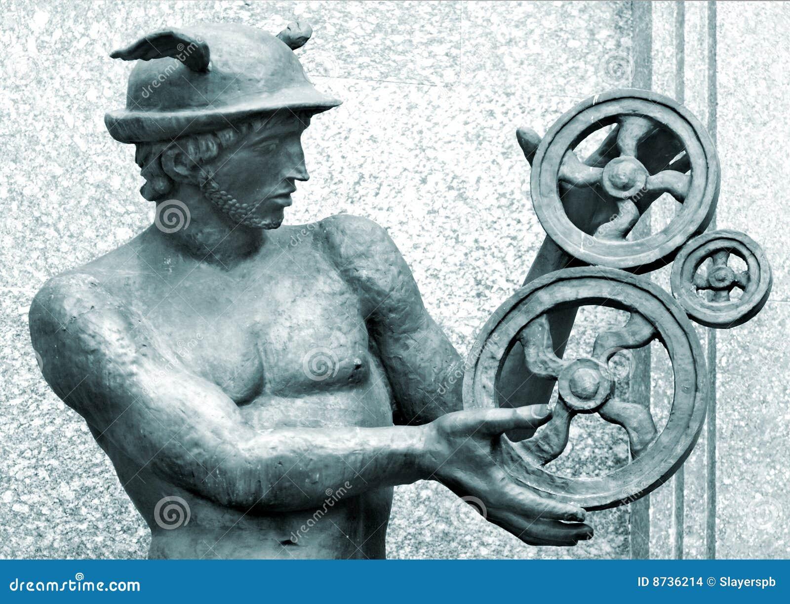 De wielen van het metaal in de handen van het Kwik