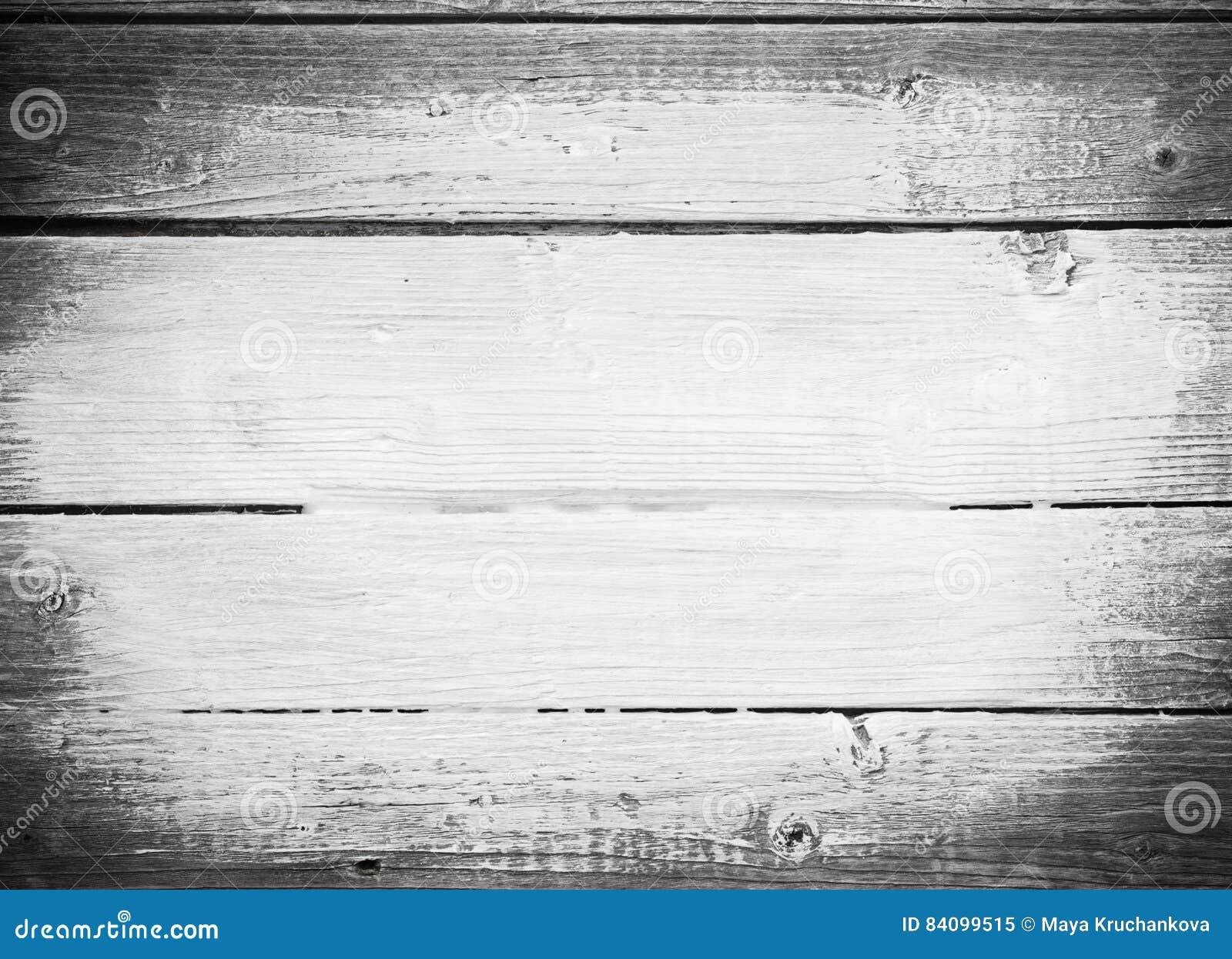 De witte slagen van de verfborstel op houten plank