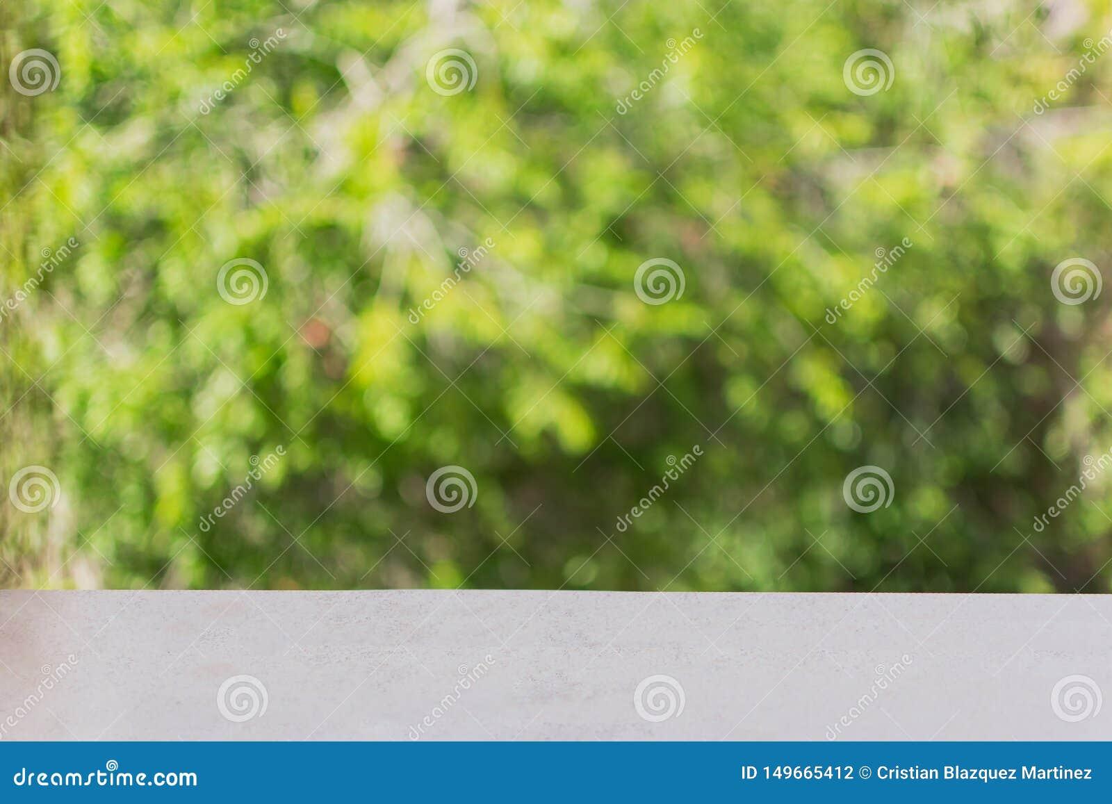 De zachte vage zoete groene abstracte achtergrond van de bokehaard