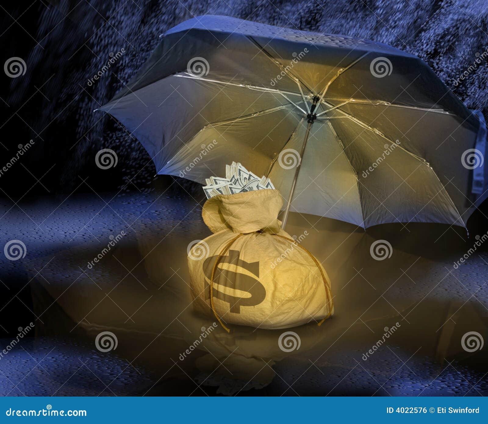 De zak van het geld onder paraplu