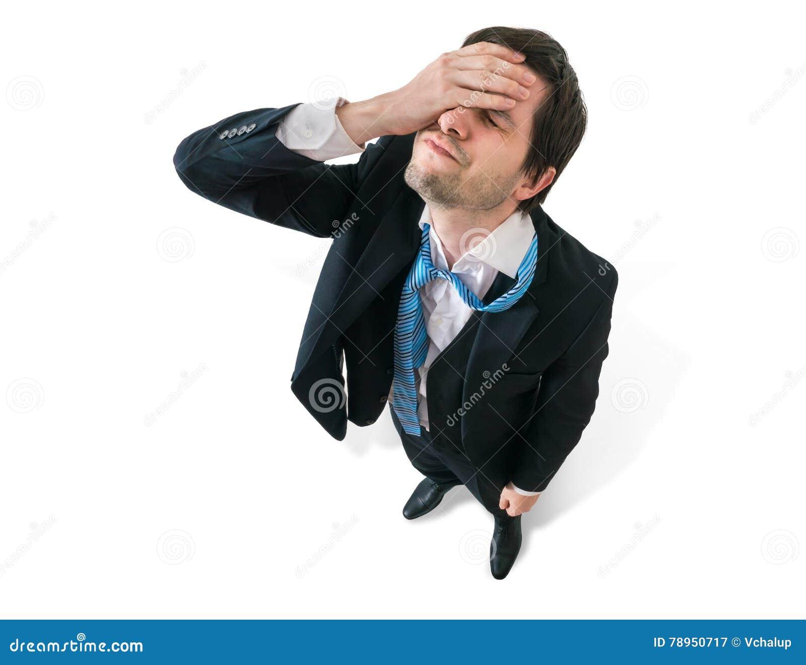 De zakenman heeft hoofdpijn Teleurstelling en mislukkingsconcept