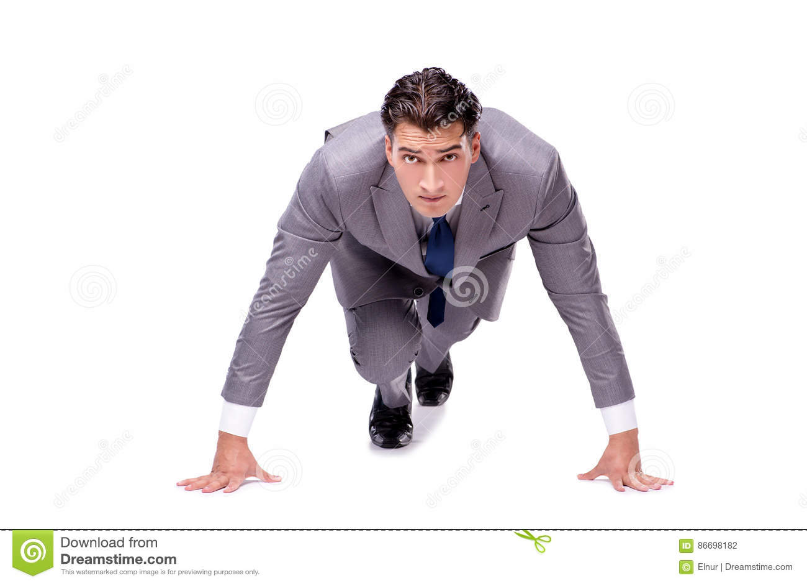 De zakenman op begin klaar voor lopen geïsoleerd op wit