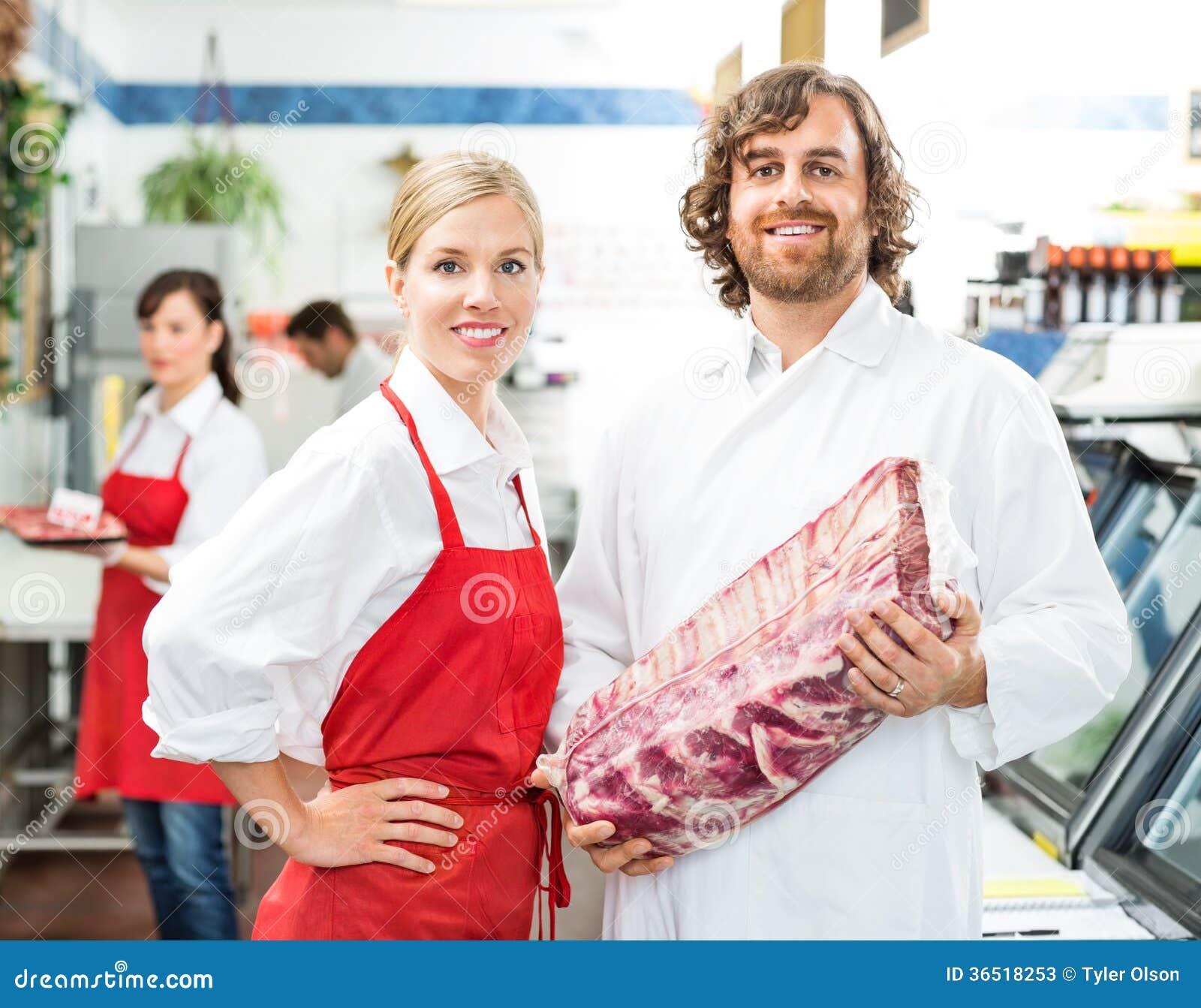 De zekere Slagers met Vlees verpakken