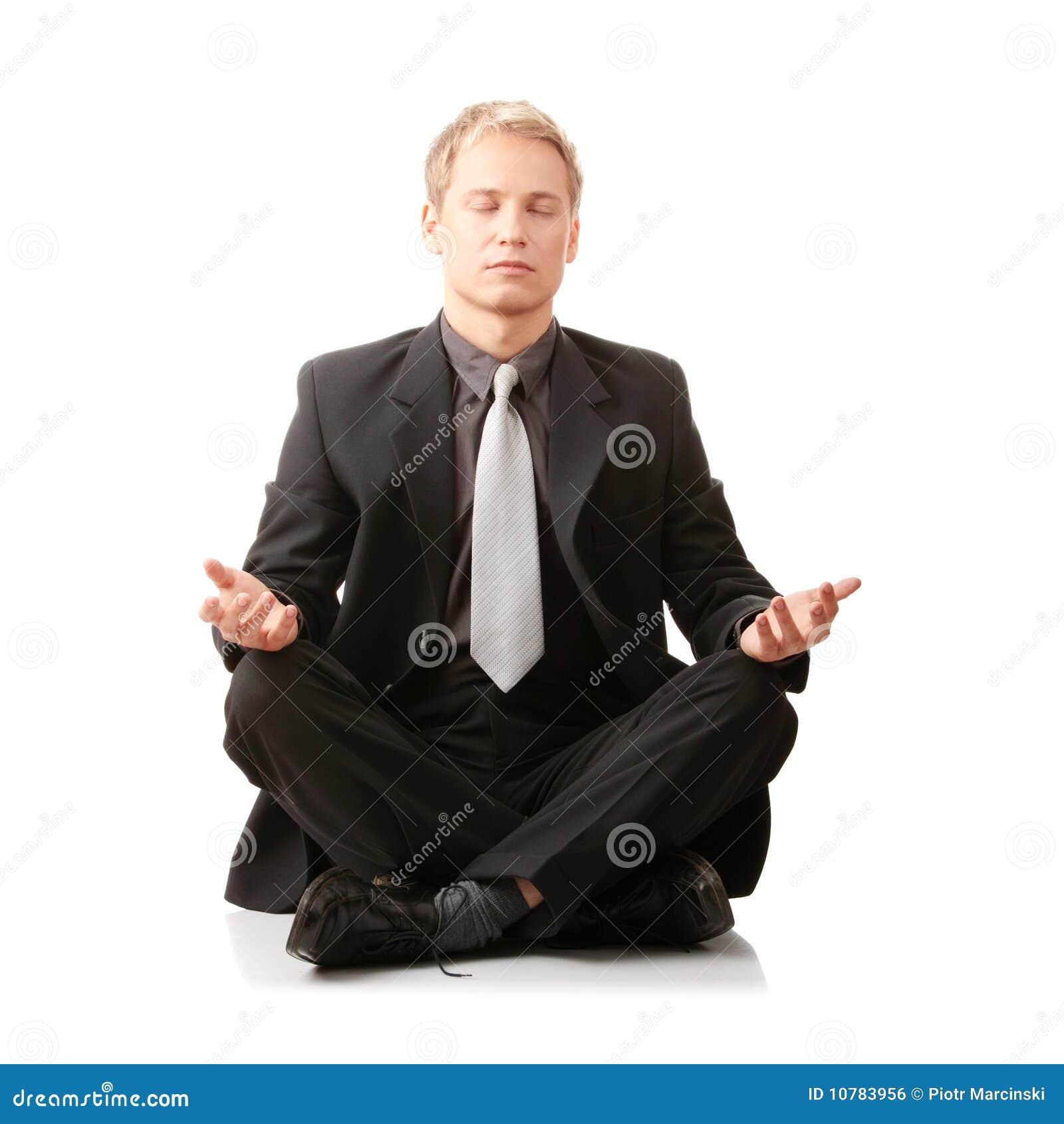De zitting van de zakenman in lotusbloempositie