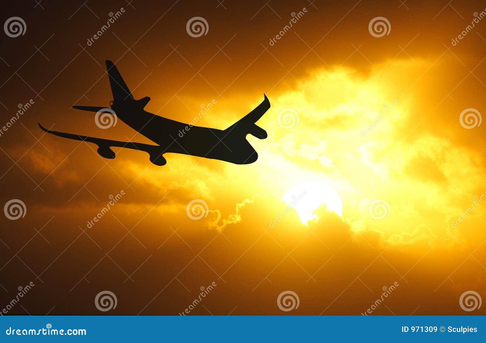 De zonsondergang van het vliegtuig