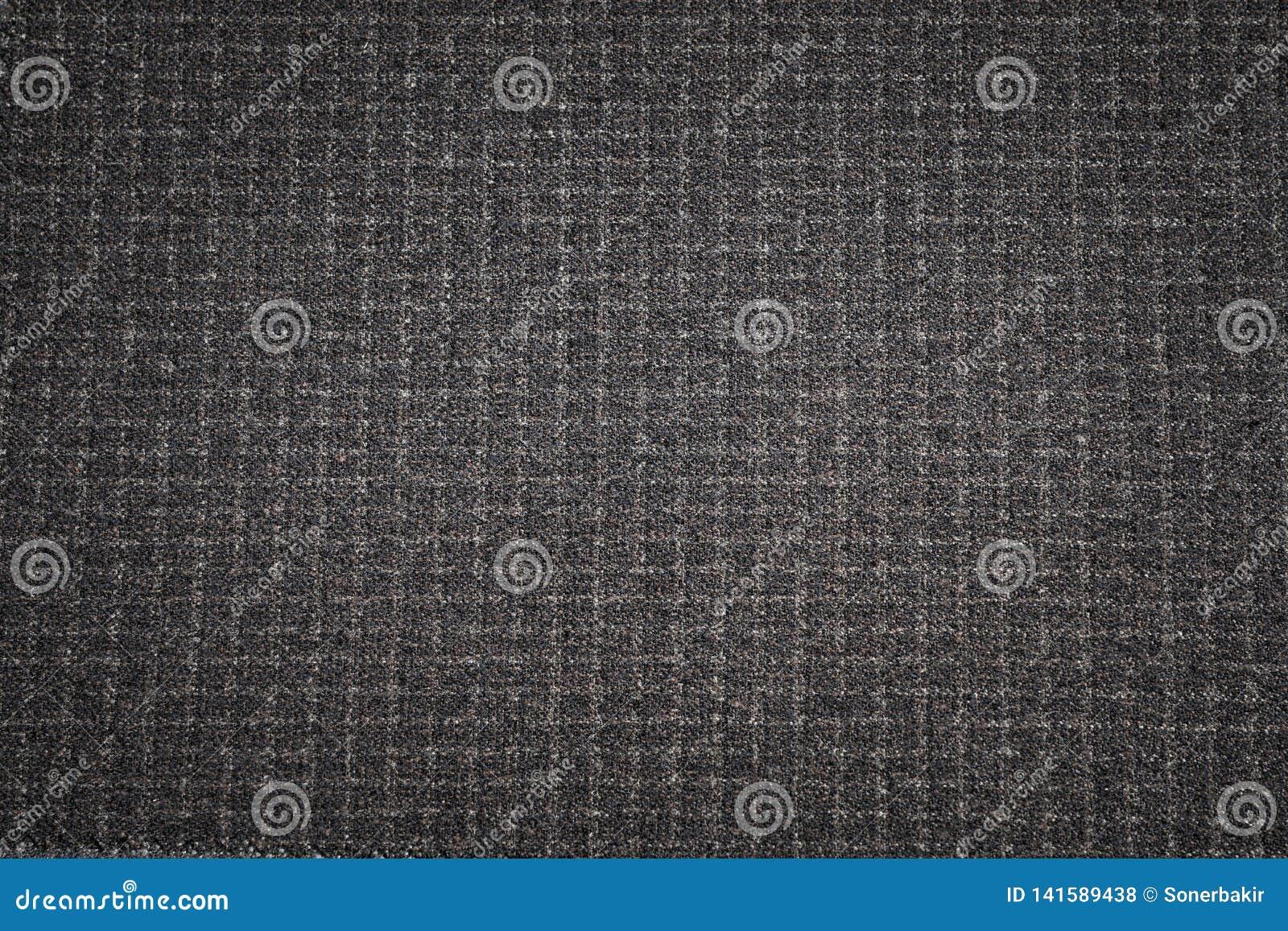 De zwarte achtergrond van de stoffentextuur Donker geweven kledend materiaal