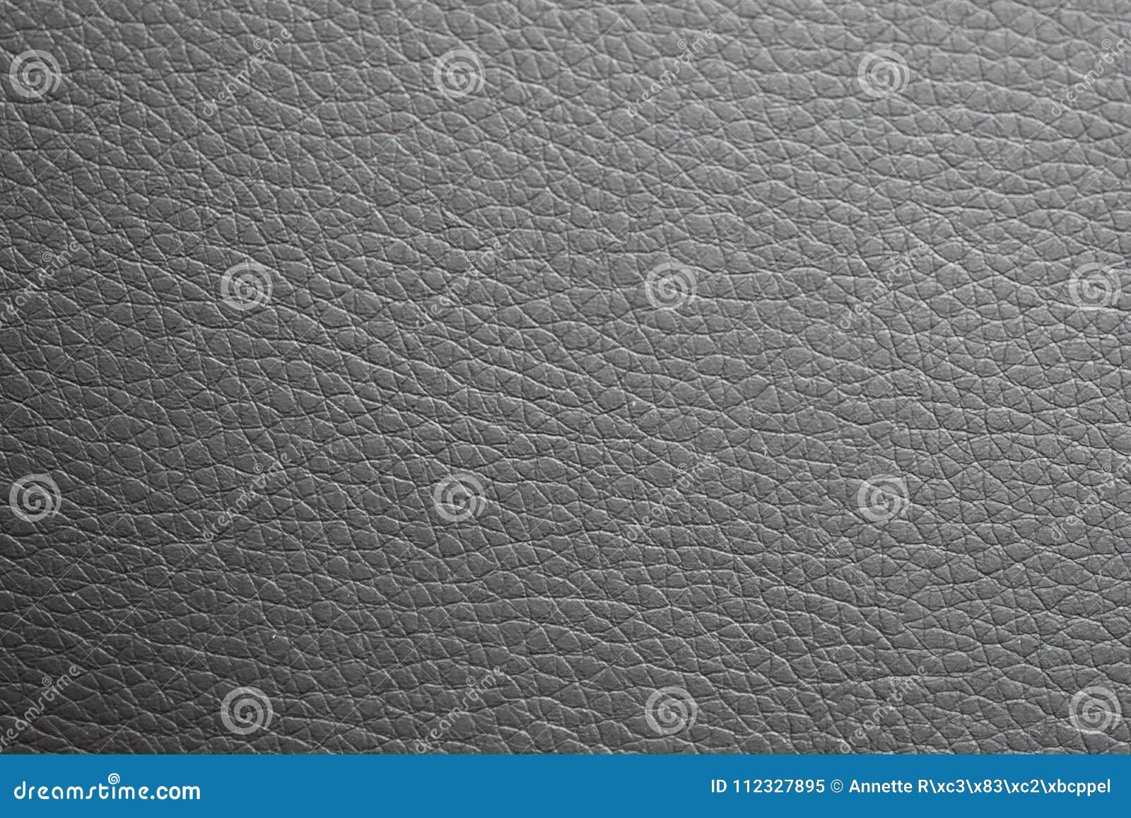 De zwarte textuur van leer, kan als achtergrond worden gebruikt