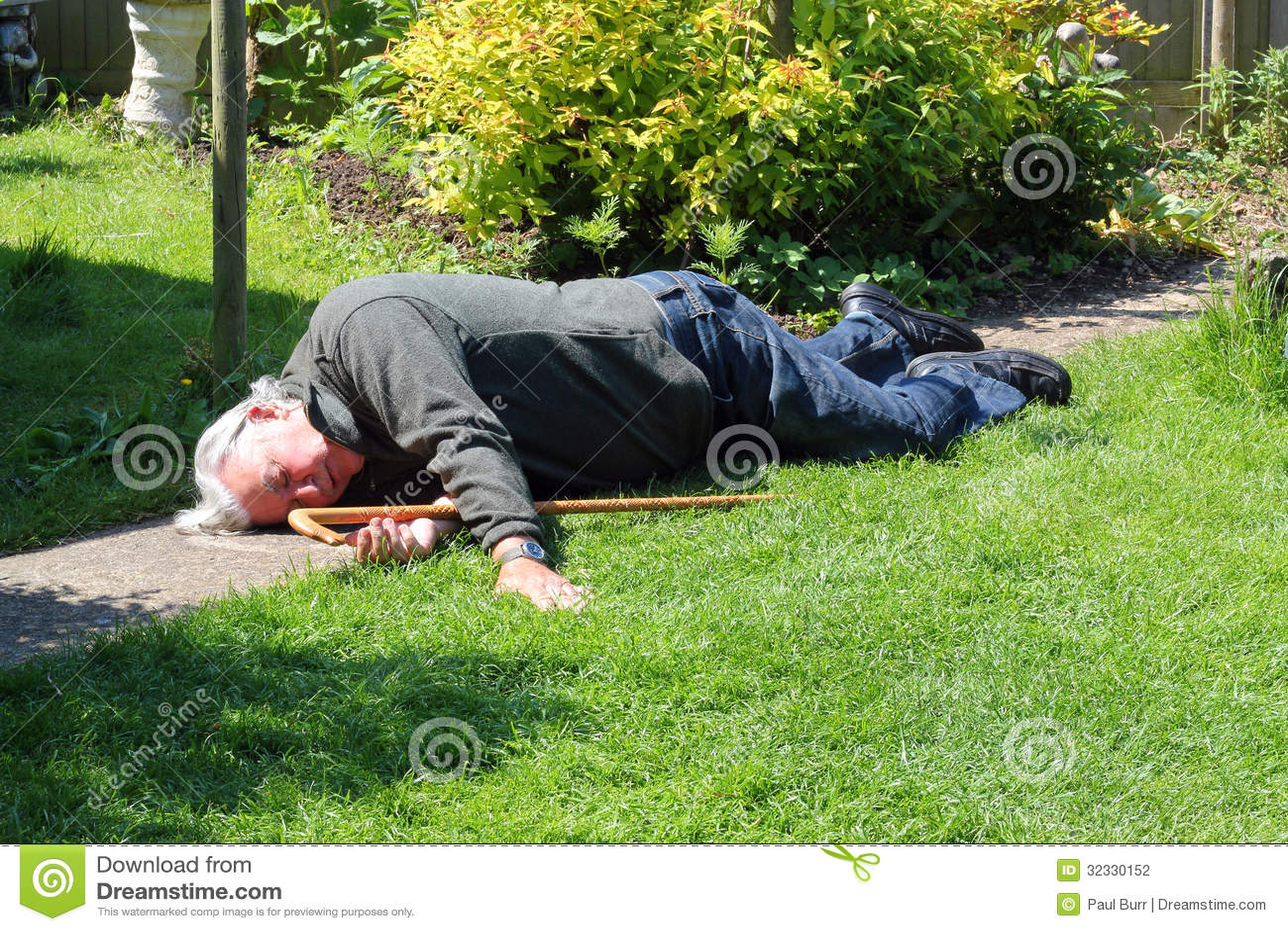 Dead or unconscious elderly man lying down.