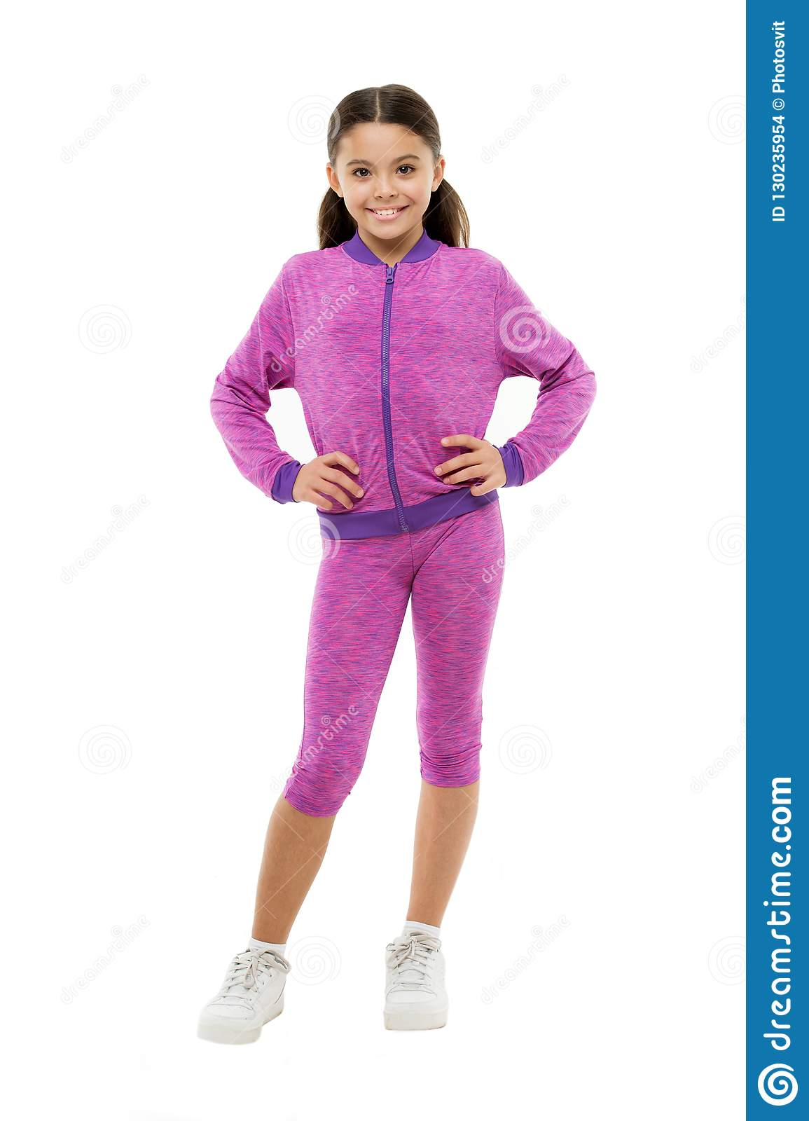Deal with long hair while exercising. Girl cute kid with long ponytails wear sportive costume isolated on white. Working