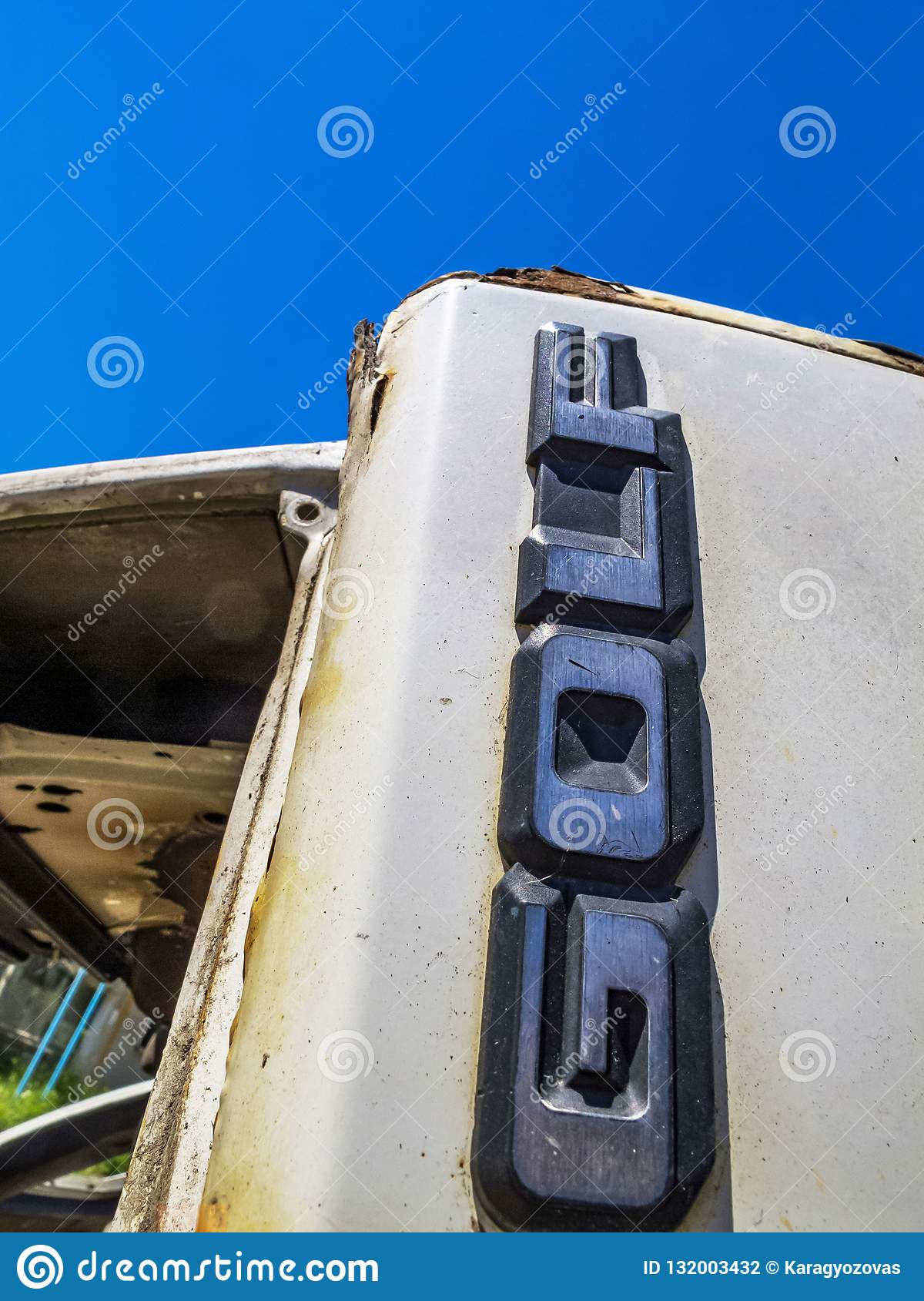 Close-up of the rear badge of a white dilapidated Volkswagen Golf Mk2 in the Bulgarian village of Debnevo