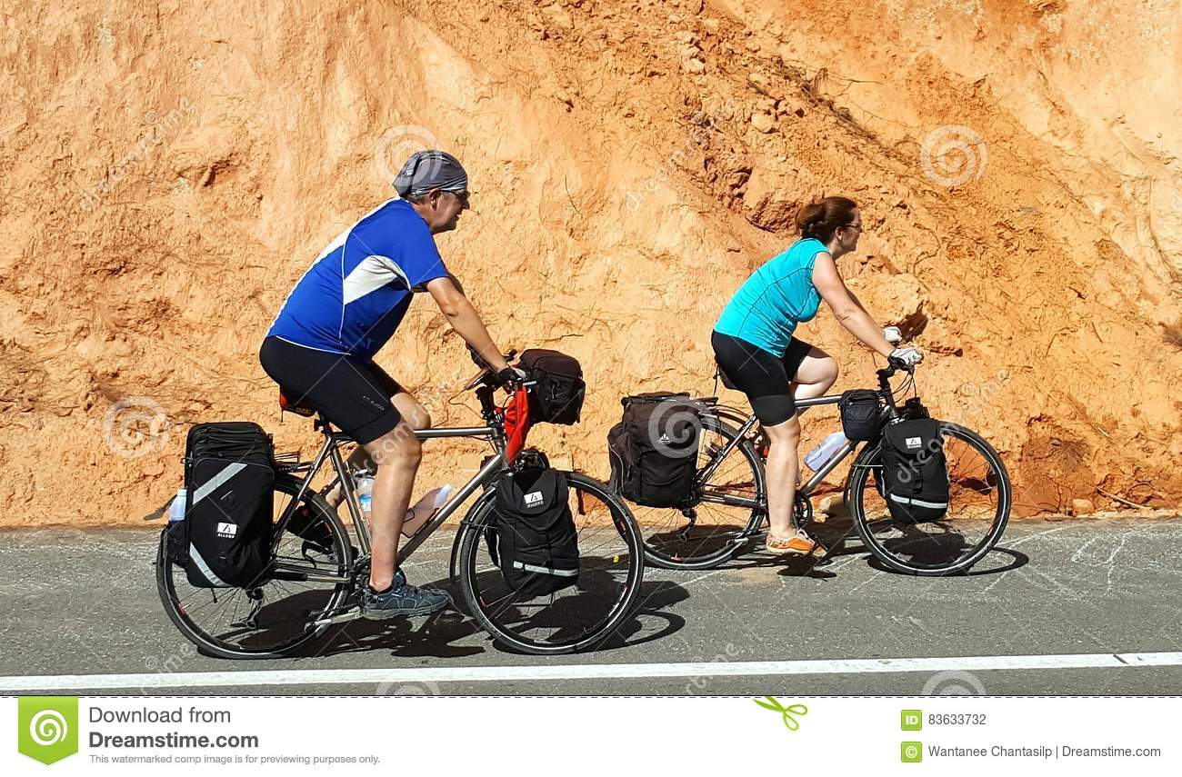 December 22, 2016- Chaing Mai, Thailand : Senior couple of cyclists riding bicycles on the road