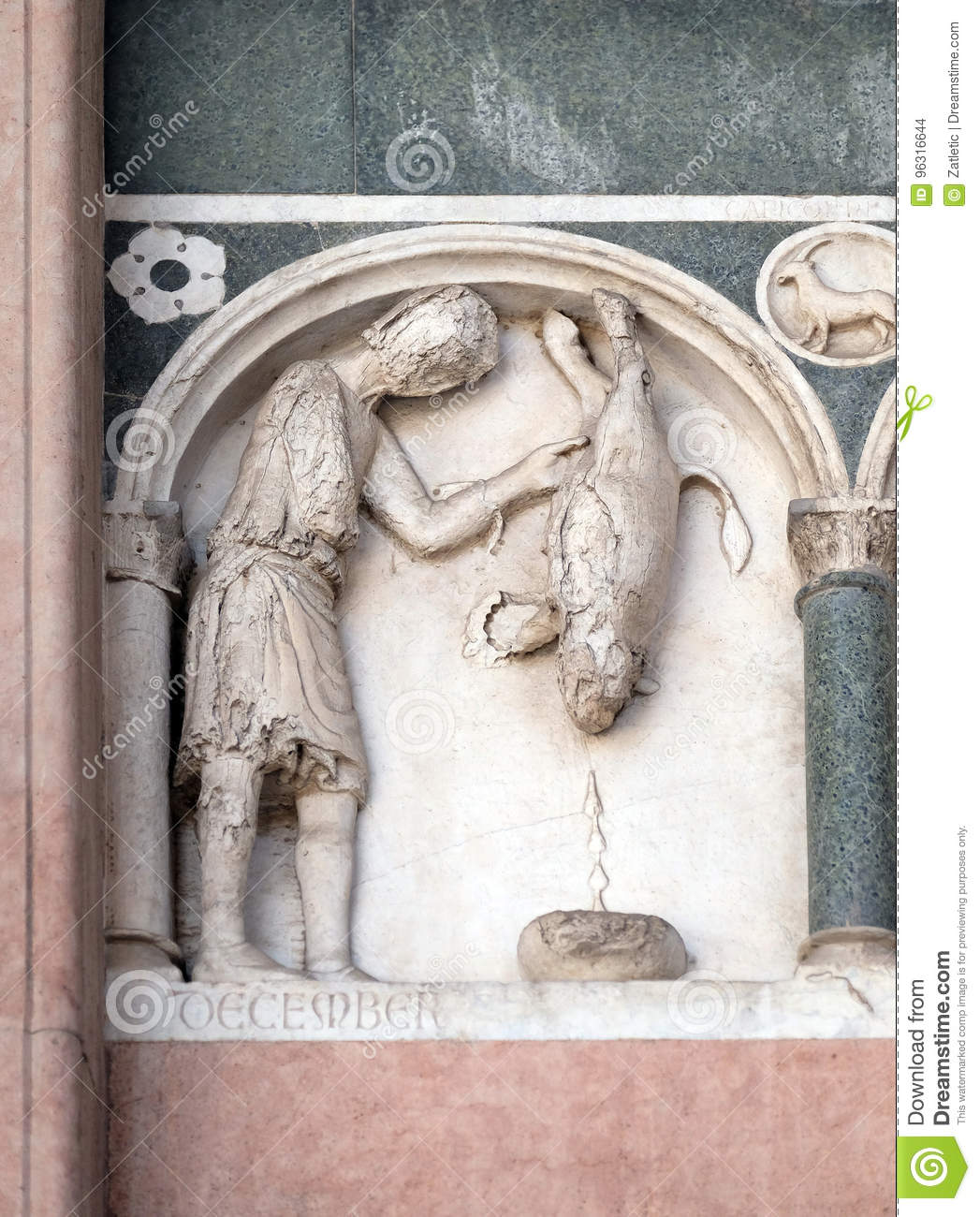 December, detail of the bass-relief representing the Labor of the months of the year, Cathedral in Lucca, Italy