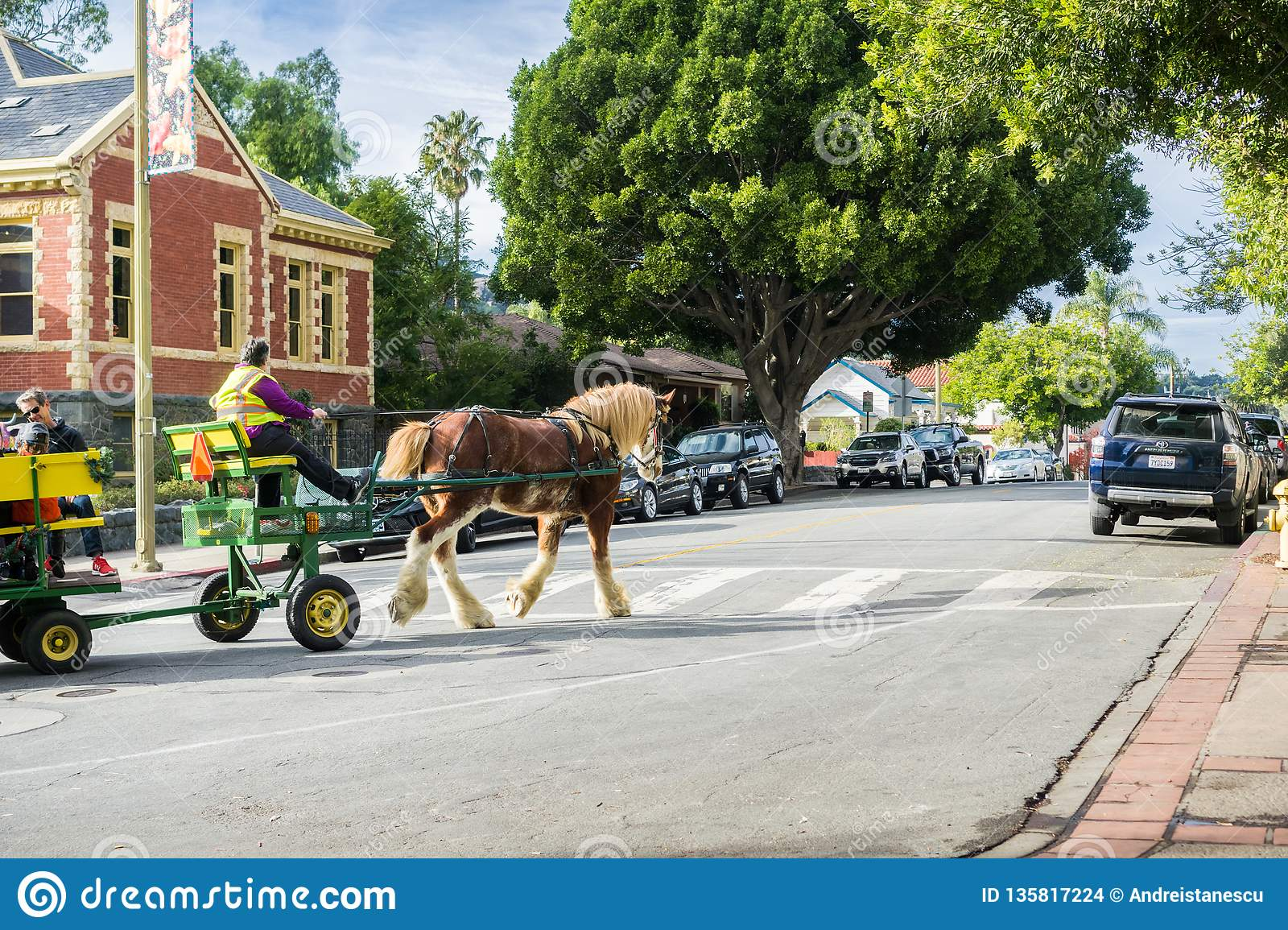 December 24, 2017 San Luis Obispo / CA / USA - Horse-drawn carriage taking people for a tour around the historical part of the