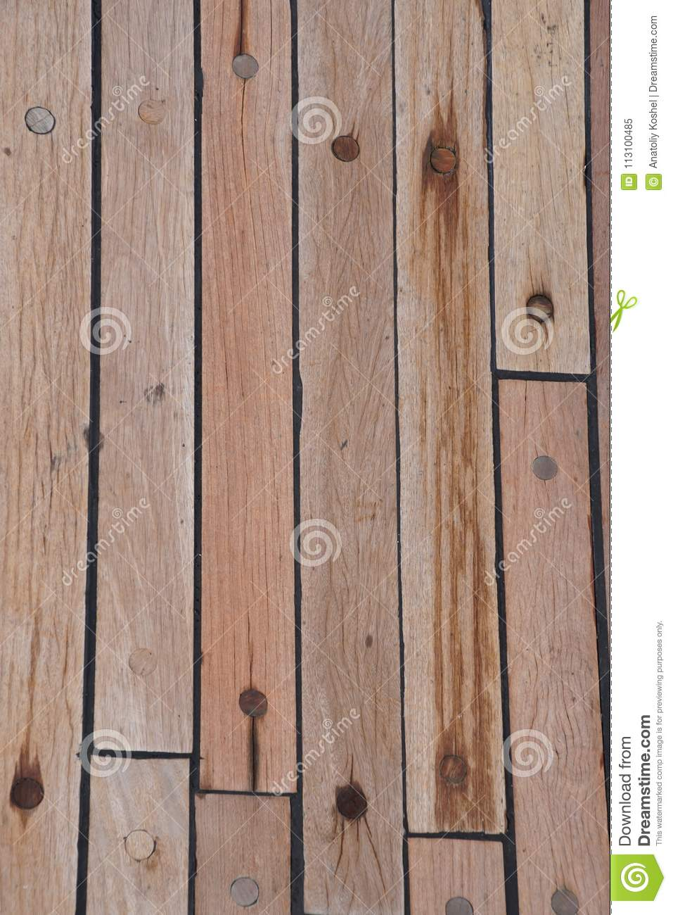 The deck is on the ship. wood texture. surface. brown.