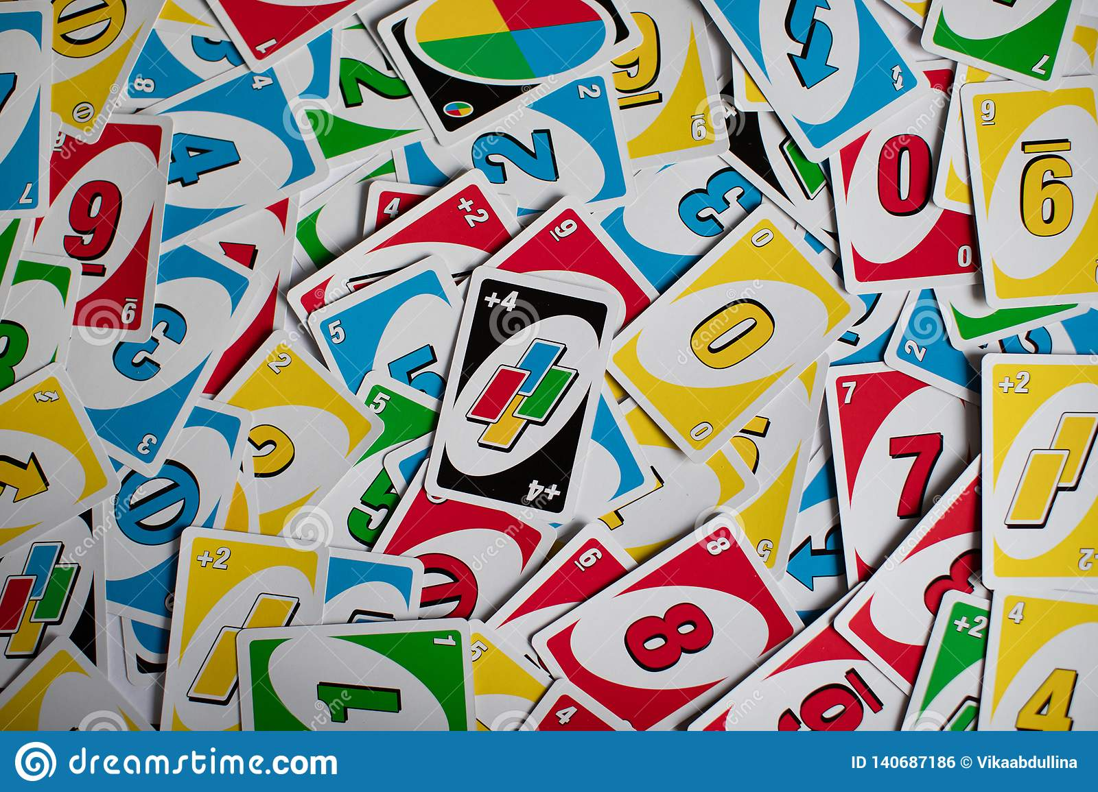 Deck Of Uno Game Cards Scattered All Over On A Table