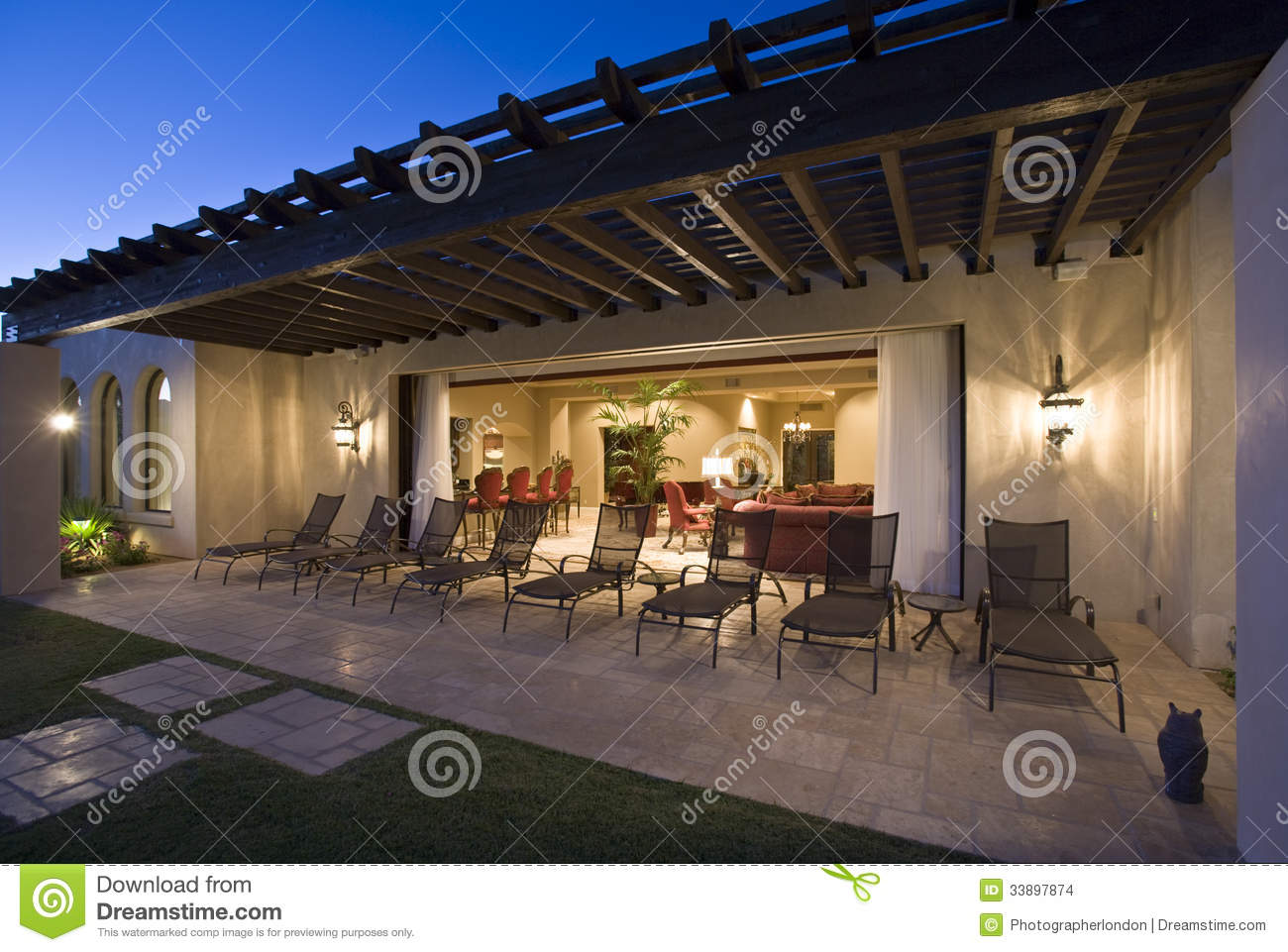 Deckchairs on patio outside house stock photo image of outdoors