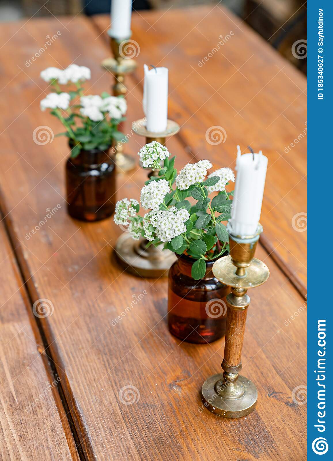 Decor Of Dining Table Candles And Small White Flowers Stock Image Image Of Flowers Tree 185340627