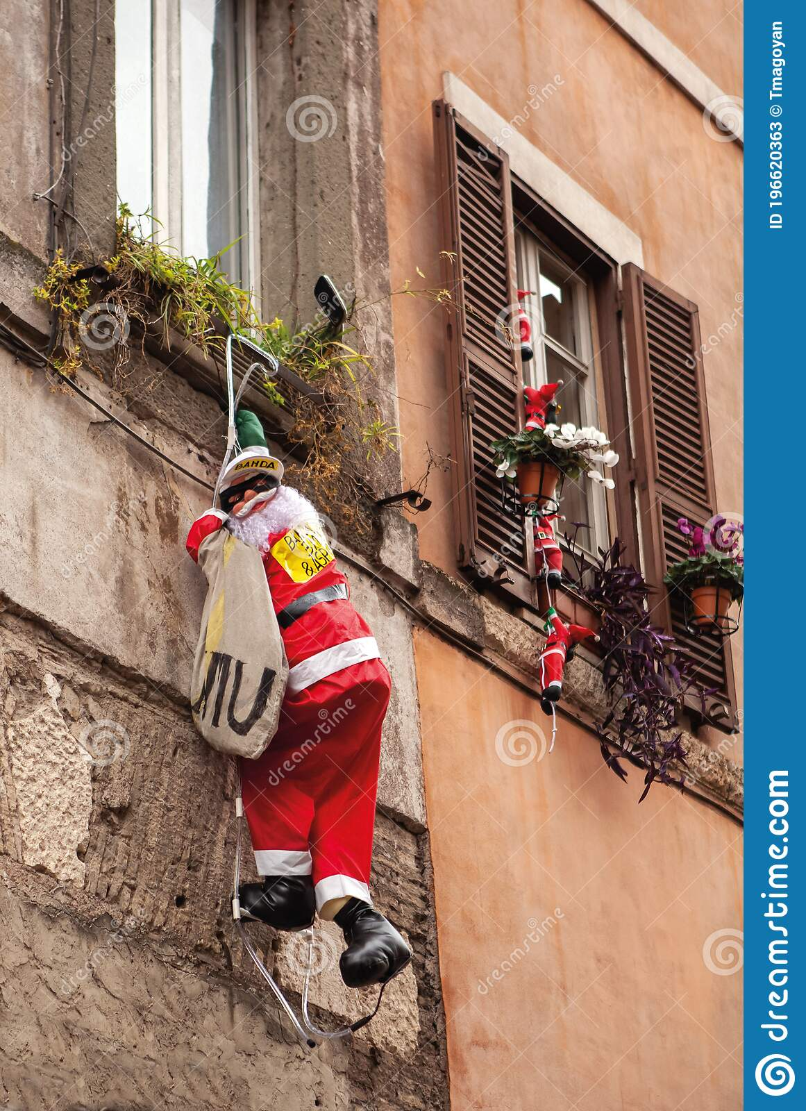 Decor In Form Of Santa Claus Hangs On Wall Of House Funny Traditional Christmas Decoration Toy Santa With Bag Of Gifts Climbing Editorial Stock Photo Image Of Happy Ladder 196620363