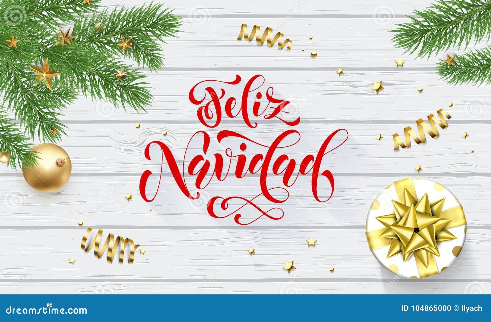 Decoración de oro del día de fiesta de Feliz Navidad Spanish Merry Christmas en el árbol de Navidad, fuente de la caligrafía para
