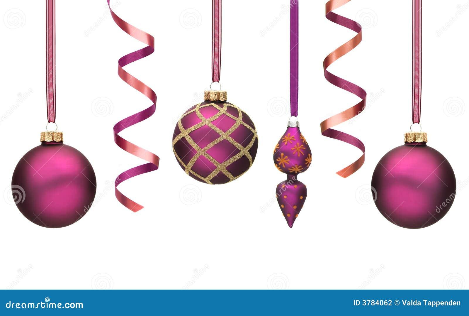 Decoraciones púrpuras de la Navidad aisladas en blanco