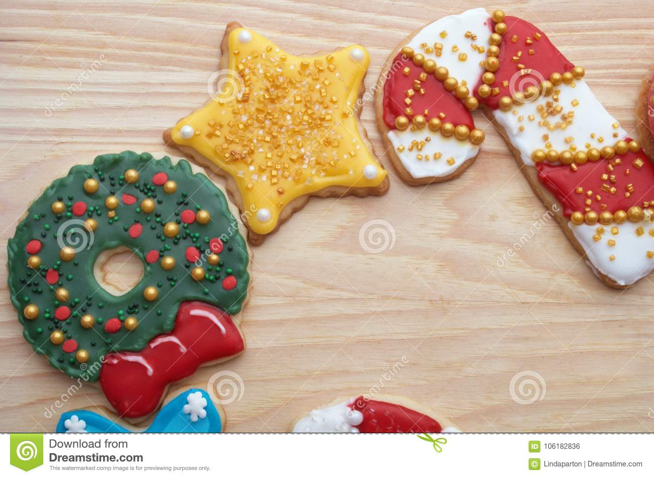 Decorated Christmas Cut Out Cookies On Natural Wood Grain Stock