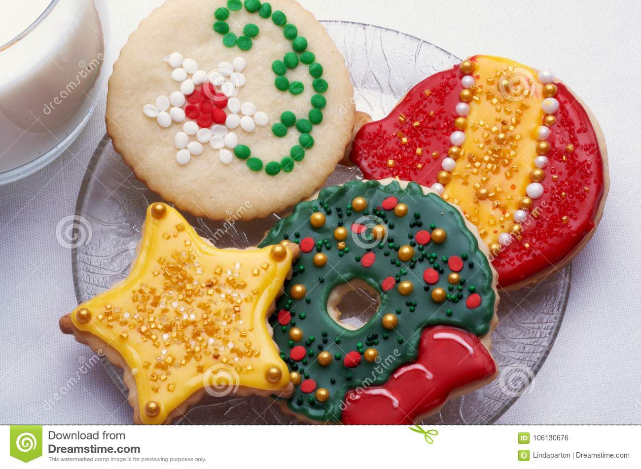 Decorated Christmas Cut Out Cookies On Plate With Glass Stock Photo