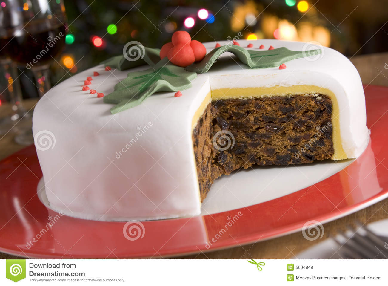 Decorated christmas fruit cake with slices taken stock for Iced christmas cakes