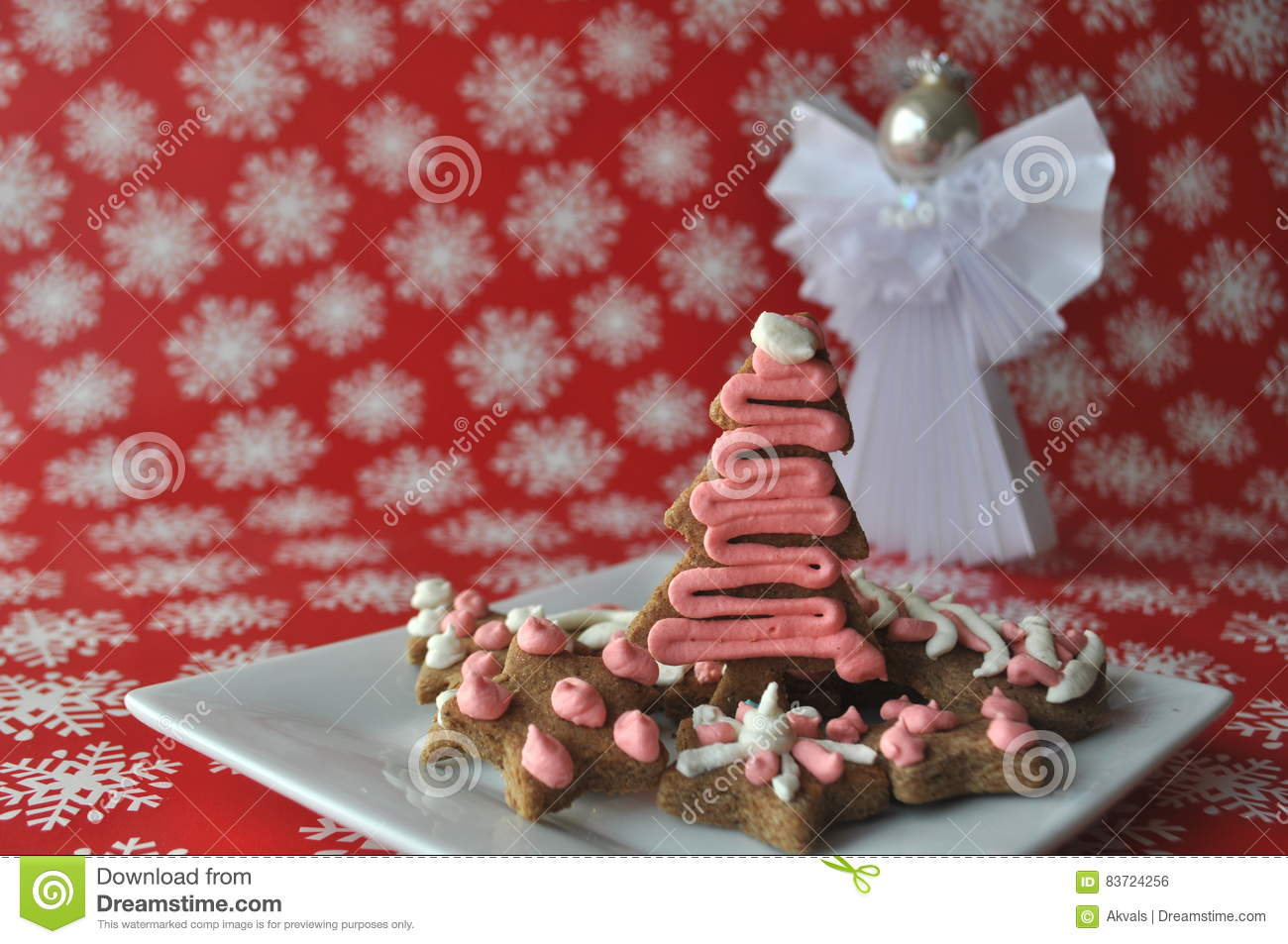 Decorated Christmas Honey Cookies On Winter Background With Snowflakes