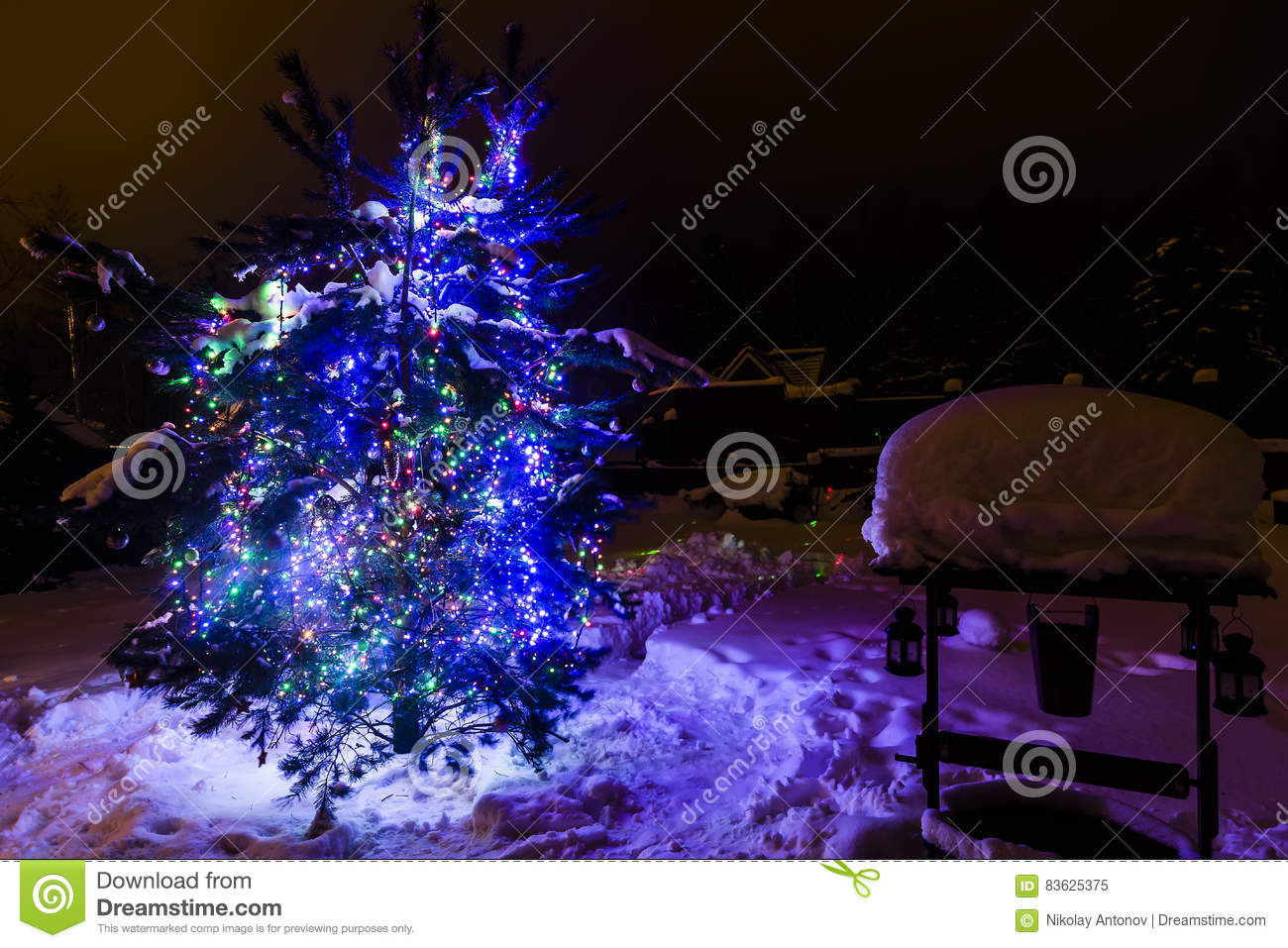download decorated christmas tree outside with lights covered with snow stock image image of holiday