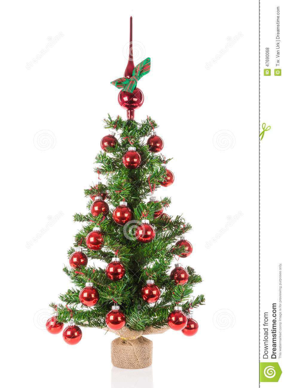 Decorated christmas tree with peak balls over a white