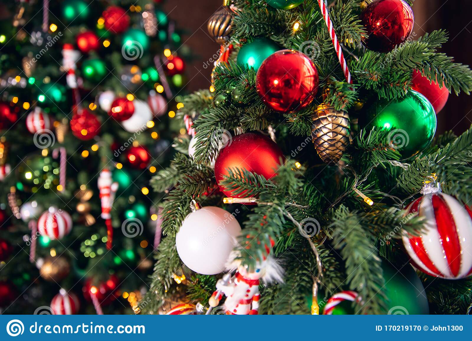 Decorated Christmas Tree Red And Green Color Close Up Of Toys And Decor Striped Candy Stock Photo Image Of Holiday Lights 170219170