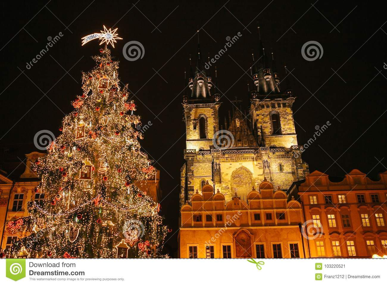 download decorated christmas tree stands on the main square in prague during the new year holidays