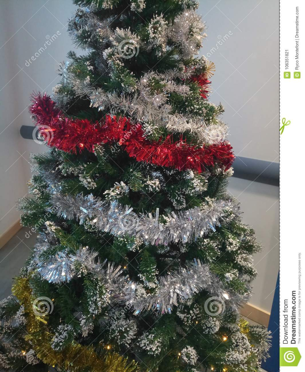 Christmas Tree Tinsel.Decorated Christmas Tree With Tinsel And Fake Snow Stock