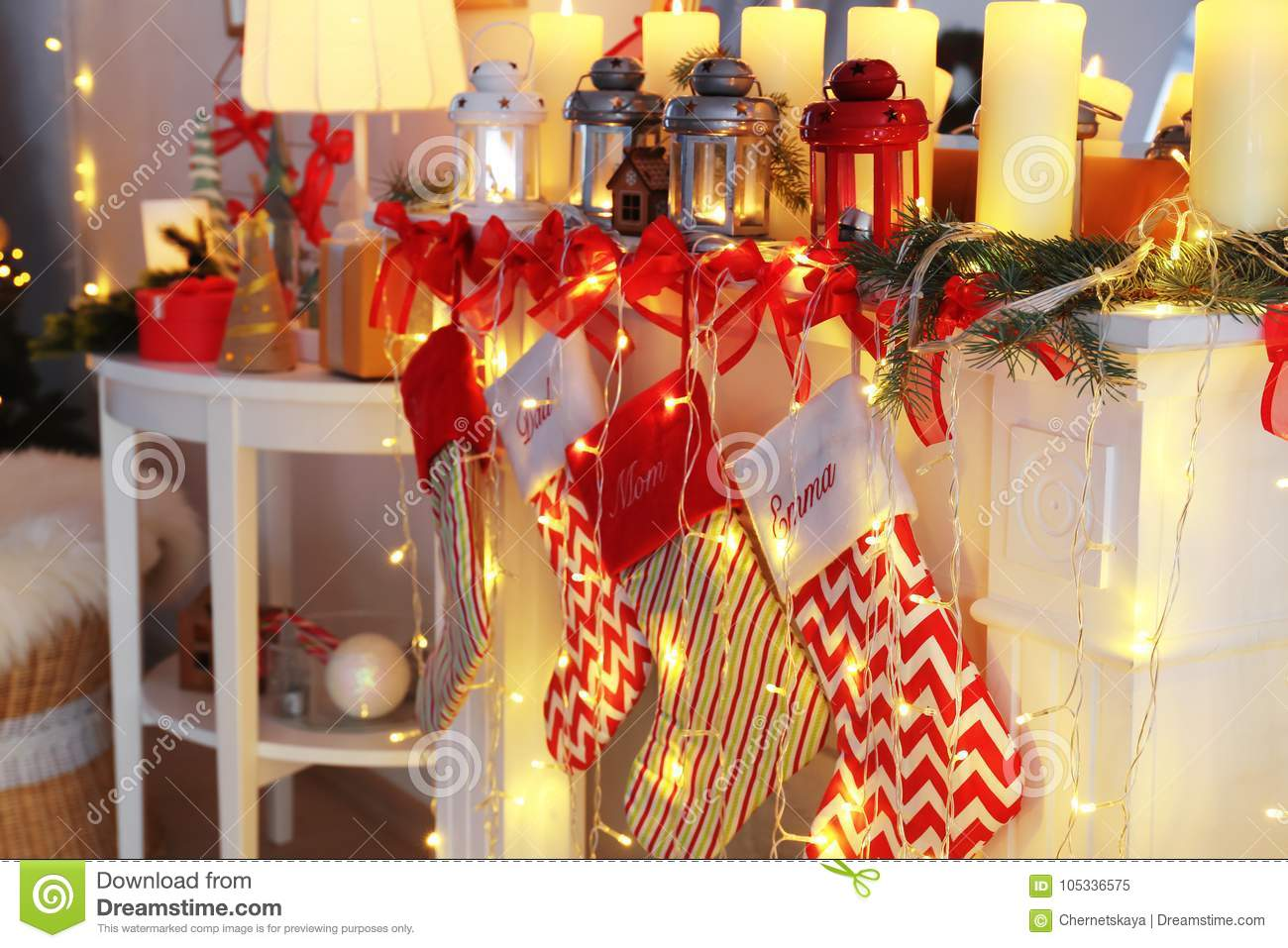 Christmas Lanterns.Decorated Fireplace With Christmas Lanterns Candles And