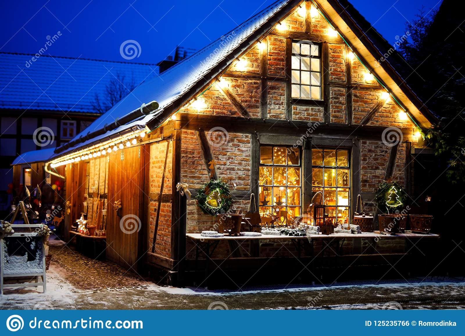 download decorated house on christmas in germany covered with snow festive lights garlands - When Is Christmas In Germany