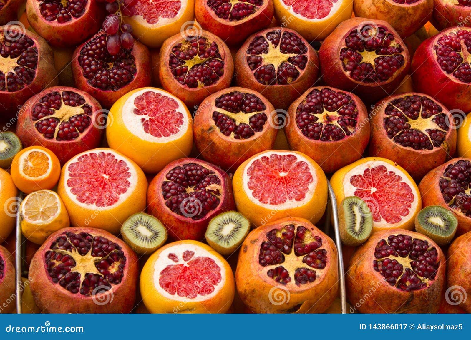 Decorated Orange, Pomegranate and Kiwi on the Market Shelf