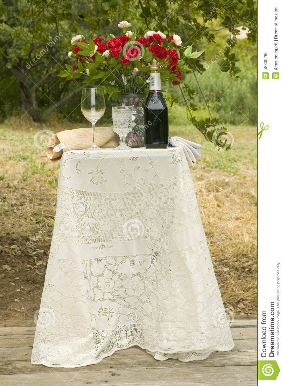 Decorated Table With Bottle Of Red Wine Glasses And