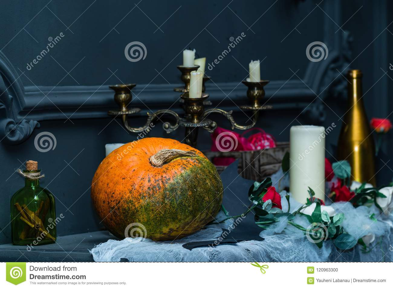 Decorated table with Halloween pumpkin jack and candleholder. De