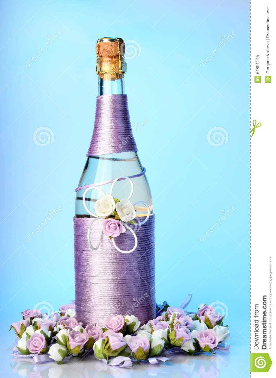 Decorated Wedding Bottle Of Champagne With Roses Isolated Stock