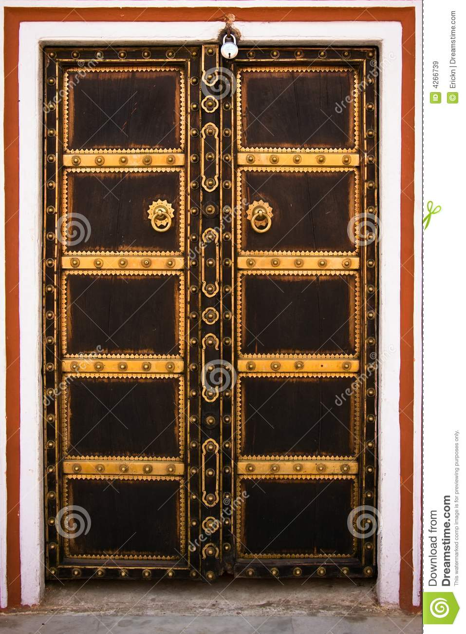 Decorated wooden door in the City Palace - Jaipur, Rajasthan, India.