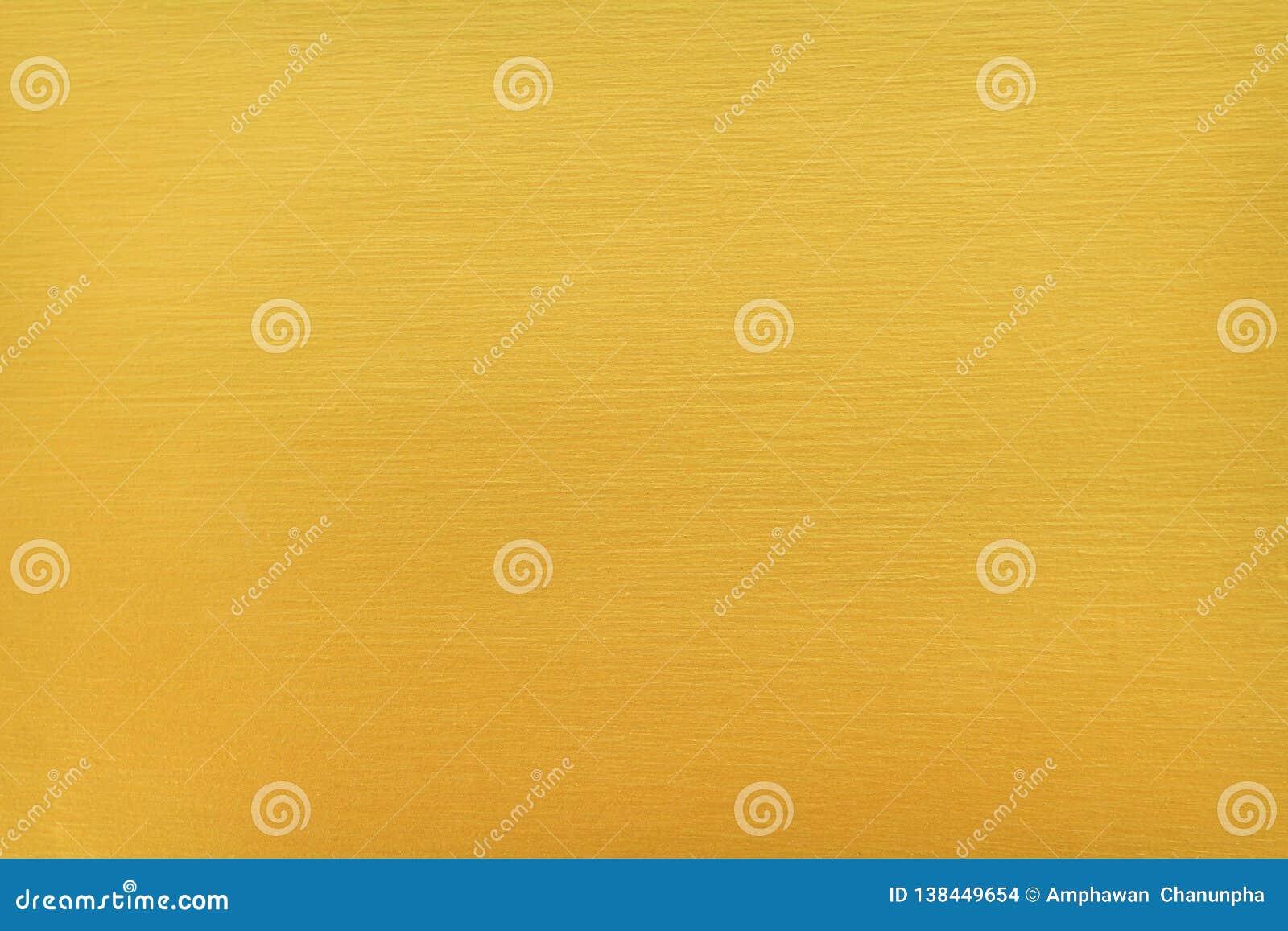 Decoratieve lichte gouden verf op concrete de textuursamenvatting van muurpatronen voor achtergrond