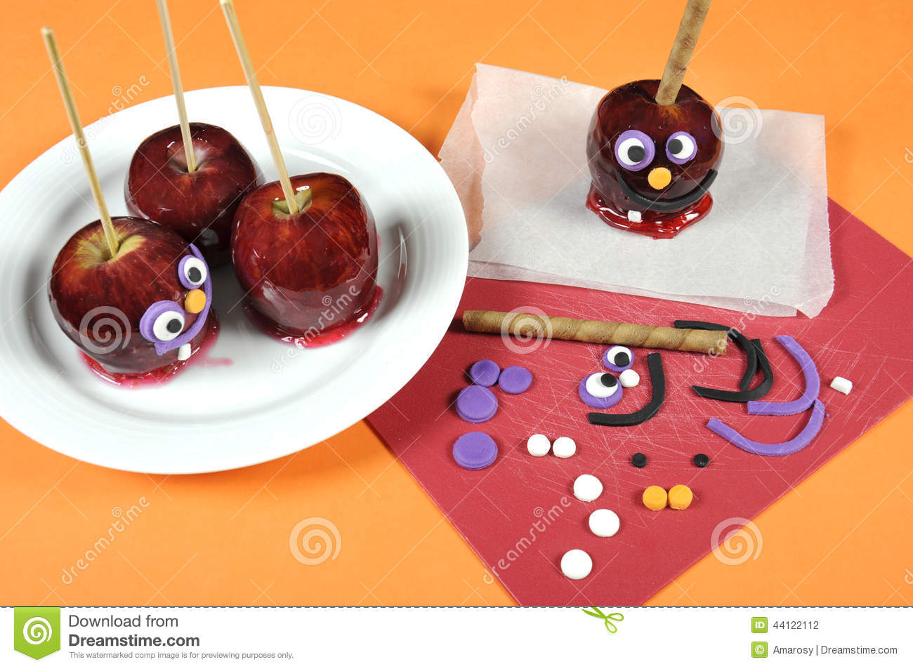 Decorating red toffee apples with funny crazy smiling for Apples decoration